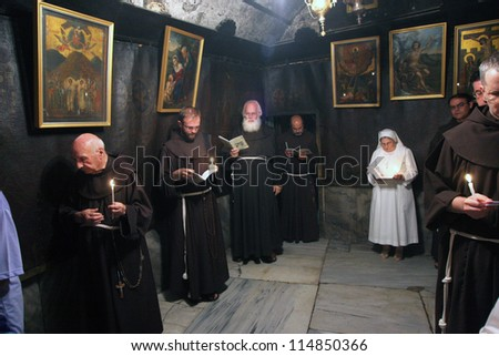 BETHLEHEM-JANUARY 03: Pilgrims participating in the procession which starts from the church of St. Catherine and go to the Basilica of the Birth of Jesus, Bethlehem, Israel on Jan 03, 2008. - stock photo