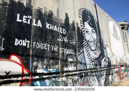 BETHLEHEM, OCCUPIED PALESTINIAN TERRITORIES - OCTOBER 7, 2014: Activist graffiti adorns the Israeli separation wall in the West Bank town of Bethlehem on October 7, 2014.