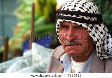 BETHLEHEM, PALESTINIAN TERRITORIES - MAY 28: An elderly Palestinian man sits at in the  Bethlehem marketplace during a brief lull during curfew imposed by occupying Israeli forces on May 28, 2002.