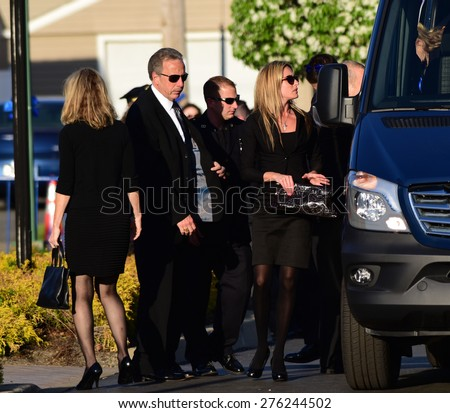 BETHPAGE, LONG ISLAND - MAY 7 2015: a formal viewing for slain NYPD officer Brian Moore, attended by thousands of police officers from North America. Family of Brian Moore arrives at mortuary, - stock photo