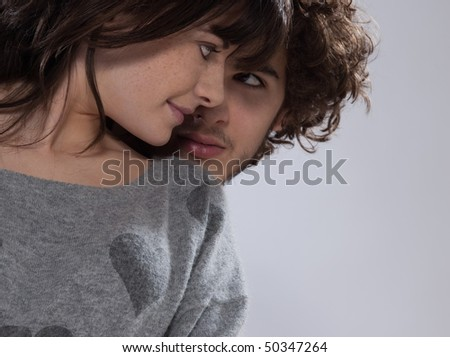 beuatiful caucasian young couple wearing a sweater with hearts on it - stock photo