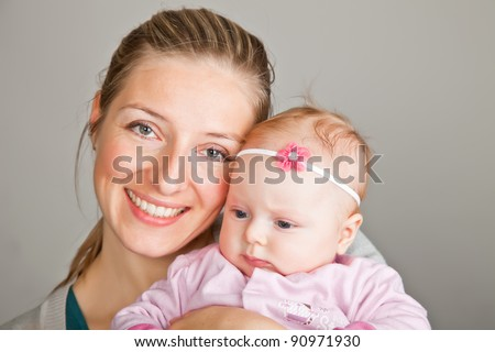 Beutiful infant baby girl in pink