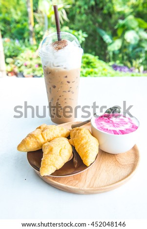 Beverages with fresh croissants on white table, Thailand - stock photo