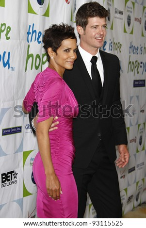 BEVERLY HILLS - APR 17: Halle Berry, Robin Thicke at the Silver Rose Awards Gala held at the Beverly Hills Hotel, Beverly Hills, California on April 17, 2011. - stock photo