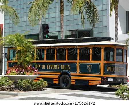 BEVERLY HILLS, CA - AUG 21: Famous Rodeo drive street in Beverly Hills, Ca on Aug. 21, 2013. Beverly Hills is world-famous for its luxurious culture and famous residents - stock photo