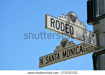 BEVERLY HILLS, CA - AUG 21: Road sign in Beverly Hills, Ca on Aug. 21, 2013. Beverly Hills is world-famous for its luxurious culture and famous residents - stock photo