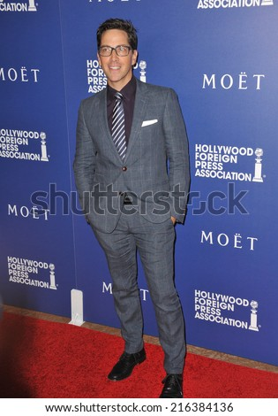 BEVERLY HILLS, CA - AUGUST 14, 2014: Actor Dan Bucatinsky at the Hollywood Foreign Press Association's annual Grants Banquet at the Beverly Hilton Hotel.  - stock photo