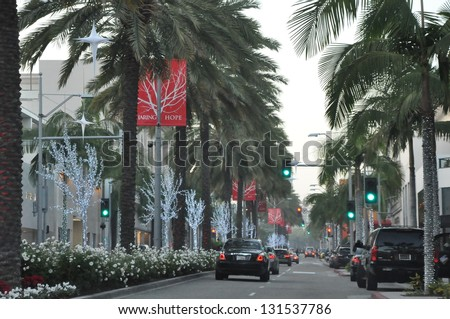 BEVERLY HILLS, CA - DEC 7: Rodeo Drive in Beverly Hills on December 7, 2012. Rodeo Drive is an affluent shopping district known for designer label and haute couture fashion. - stock photo