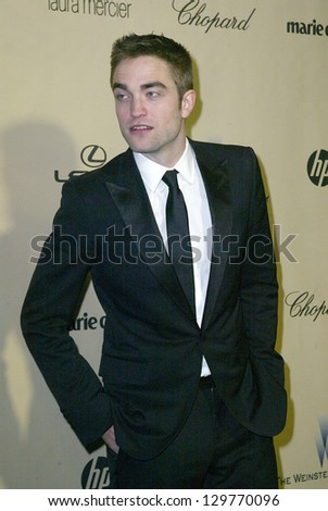 BEVERLY HILLS, CA - JAN. 13: Robert Pattinson arrives at the Weinstein Company's 2013 Golden Globes After Party on Sunday, January 13, 2013 at the Beverly Hilton Hotel in Beverly Hills, CA. - stock photo