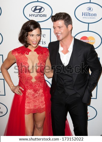 BEVERLY HILLS, CA. - JANUARY 25: Paula Patton & Robin Thicke arrive at the Clive Davis & The Recording Academy annual Pre-GRAMMY Gala on January 25th 2014 at the Beverly Hilton in Beverly Hills.