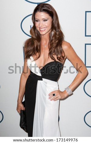 BEVERLY HILLS, CA. - JANUARY 25: Shannon Elizabeth arrives at the Clive Davis and The Recording Academy annual Pre-GRAMMY Gala on January 25th 2014 at the Beverly Hilton in Beverly Hills, California. - stock photo