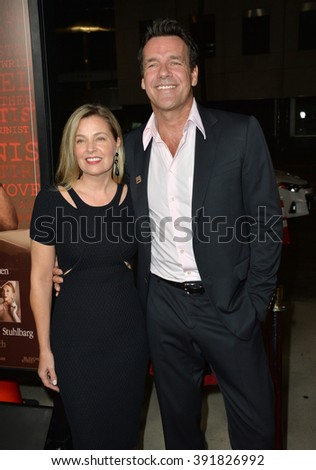 "BEVERLY HILLS, CA - OCTOBER 27, 2015: Actor David James Elliott & wife Nanci Chambers at the US premiere of his movie ""Trumbo"" at the Academy of Motion Picture Arts & Sciences - stock photo"