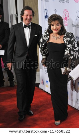 BEVERLY HILLS, CA - OCTOBER 20, 2012: Joan Collins & husband Percy Gibson at the 26th Carousel of Hope Gala at the Beverly Hilton Hotel. - stock photo