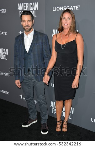 "BEVERLY HILLS, CA. October 13, 2016: Tony Horton & Shawna Brannon at the Los Angeles premiere of ""American Pastoral"" at The Academy's Samuel Goldwyn Theatre."