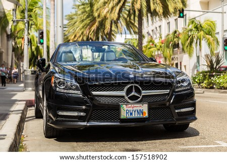 BEVERLY HILLS, CA - SEP 20: Mercedes Benz in Rodeo Drive in Beverly Hills on September 20, 2013. Rodeo Drive is an affluent shopping district known for designer label and haute couture fashion. - stock photo