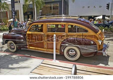 """BEVERLY HILLS, CALIFORNIA - JUNE 15, 2014: 1942 Chrysler Town and Country """"Barrelback"""" owned by Aaron Weiss at the Rodeo Drive Concours D'Elegance on  June 15, 2014 Beverly Hills, California, USA - stock photo"""