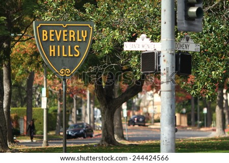 BEVERLY HILLS, CALIFORNIA - NOV 10 2014: The famous Beverly Hills symbol and sign on the corner of Santa Monica Blvd. and Doheny. - stock photo