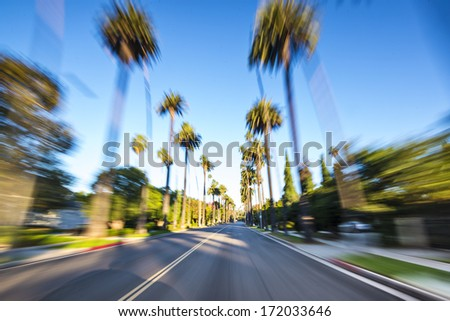 Beverly HIlls drive through with motion blur. - stock photo