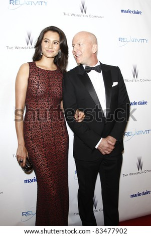 BEVERLY HILLS - JAN 16: Bruce Willis and wife Emma Heming at The Weinstein Company And Relativity Media's 2011 Golden Globe Awards Party in Beverly Hills, California on January 16, 2011 - stock photo