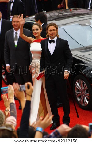 BEVERLY HILLS - JANUARY 15: Actors Angelina Jolie and Brad Pitt arriving to the Beverly Hilton Hotel for the 69th annual Golden Globe Awards ceremony January 15, 2012 Beverly Hills, CA. - stock photo
