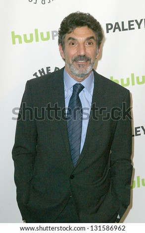 """BEVERLY HILLS - MARCH 13: Chuck Lorre arrives at the 2013 Paleyfest """"The Big Bang Theory"""" panel on March 13, 2013 at the Saban Theater in Beverly Hills, CA. - stock photo"""