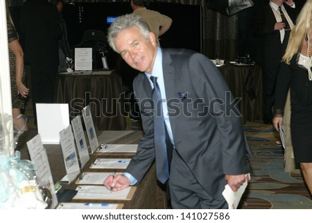 BEVERLY HILLS - MAY 7: Tony Denison checks out the silent auction items at The 12th Annual Golden Hearts Awards on Monday, May 7, 2012 at the Beverly Wilshire Hotel in Beverly Hills, CA. - stock photo