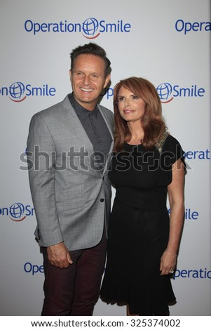 BEVERLY HILLS - OCT 2: Mark Burnett, Roma Downey at the Operation Smile's 2015 Smile Gala  on October 2, 2015 at the Beverly Wilshire Four Seasons Hotel in Beverly Hills, CA. - stock photo