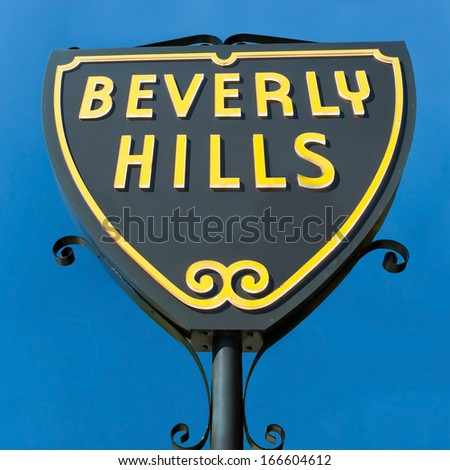 Beverly Hills sign in Los Angeles park with beautiful blue sky in background - stock photo