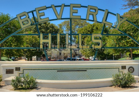Beverly Hills sign on rodeo drive view into the Los Angeles hills on AUGUST 23, 2013 in Los Angeles, USA. - stock photo