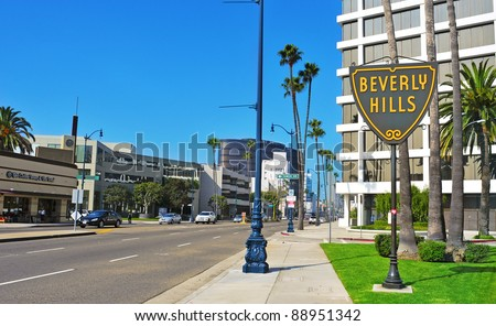BEVERLY HILLS, US -  OCTOBER 16: A Beverly Hills sign in Wilshire Boulevard on October 16, 2011 in Beverly Hills, US. The affluent city has a population of 34,109 at the 2010 census - stock photo
