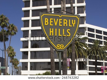 BEVERLY HILLS, USA - AUGUST 17 2013: Beverly Hills sign with a modern building below - stock photo
