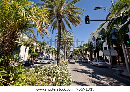 BEVERLY HILLS, USA - JULY 17: View of Rodeo Drive during sunny day on July 17, 2011 in Beverly Hills. Rodeo Drive is a shopping district famous for designer label and haute couture fashion - stock photo