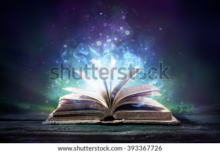 Bewitched Book With Magic Glows In The Darkness  - stock photo