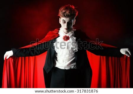 Bewitching handsome male vampire. Halloween. Dracula costume. - stock photo