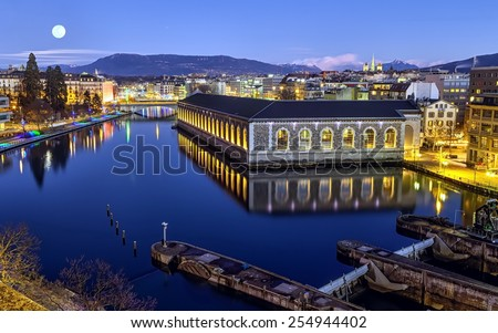 BFM, cathedral Saint-Pierre green tower and Rhone river by night with full moon, Geneva, Switzerland, HDR - stock photo