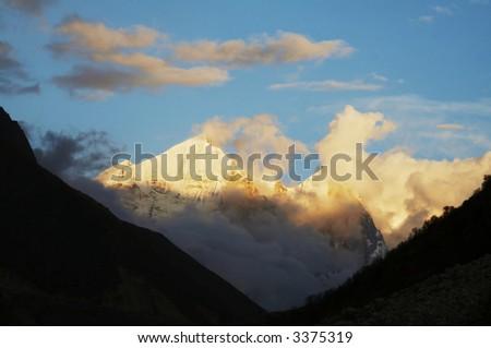 Bhagirathi Parbat peak in Himalayan on sunset - stock photo