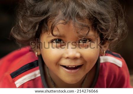 Bhaktapur, Nepal. August 31-2010.  Unidentified Nepali girl smiling - stock photo
