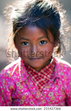 BHAKTAPUR, NEPAL - JANUARY 08: Nevaris schoolgirl Lakshmi, 8, poses for a photo during her breaktime on January 08, 2010 in Bhaktapur, Kathmandu Valley, Nepal