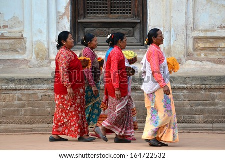 BHAKTAPUR, NEPAL - OCT 10: Women from Bhaktapur enjoying the holidays during the holy Hindu Dashain festival in the Durbar square. On October 10, 2013 in Kathmandu, Nepal