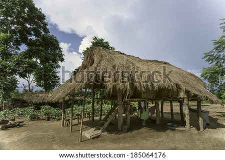 BHALUKPONG, INDIA - SEPTEMBER 13: Thatched hut on stilts typical of the Mising (aka Mishing) tribe on a sunny day on September 13, 2011 near Bhalukpong, Assam, India.