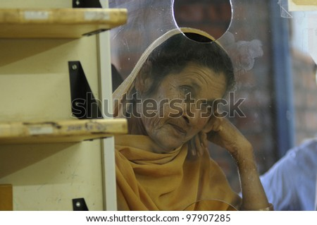 BHOPAL- DECEMBER 6:  - An old Bhopal gas survivor waiting to get free medicine from a clinic dedicated to the Bhopal victims in Bhopal India on December 6, 2010.