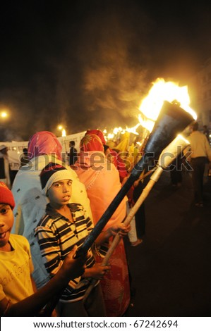 BHOPAL- DECEMBER 2: Children of Bhopal  during the torch rally organized to mark the 26th year of Bhopal gas disaster, in Bhopal - India on December 2, 2010.