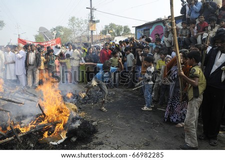 BHOPAL- DECEMBER 3: Mobs kick the effigy during the rally to mark the 26th Year of the Bhopal Gas Tragedy in Bhopal - India on December 3, 2010.