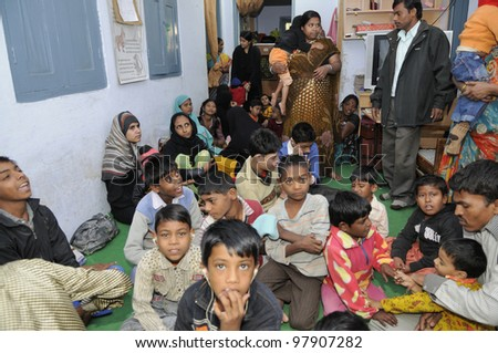 BHOPAL- DECEMBER 2:  Patients of a clinic for Bhopal victims playing during a children's day celebration in Bhopal - India on December 2, 2010. - stock photo