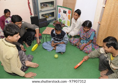 BHOPAL- DECEMBER 7:  3rd generation victims of the Bhopal gas disaster playing in a rehabilitation clinic in Bhopal - India on December 7, 2010. - stock photo