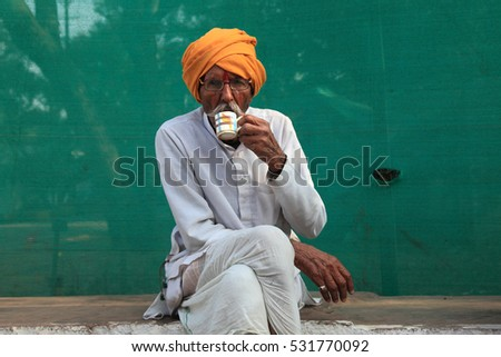 BHOPAL, INDIA - NOV 14: Unidentified senior man wearing turban from rural area drinks tea on November 14, 2016 in Bhopal, Madhya Pradesh,India. Senior men in the rural india wear turban as a custom.