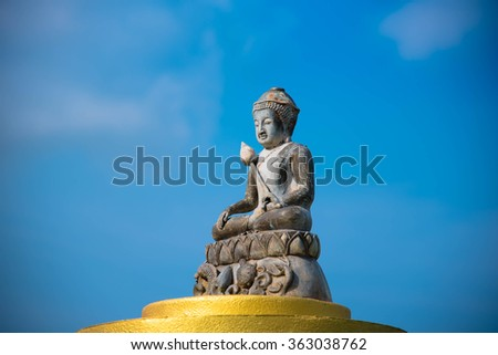 Bhuddism statue meditaion with blue sky at Wat Yan Na Sang Wara Ram in Pattaya Thailand. This photo was taken on 6-Jan-2016. This's Buddha Sculpture mediation on the gold base. Tourist need to worship