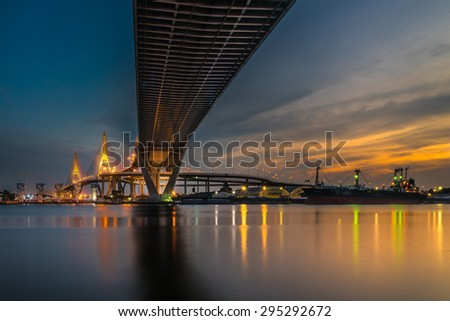 Bhumibol Bridge across the river at twilight, The Industrail Ring Road in Bangkok, Thailand - stock photo