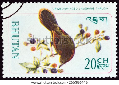 """BHUTAN - CIRCA 1968: A stamp printed in Bhutan from the """"Rare Birds """" issue shows Red-faced liocichla (Crimson-winged Laughing Thrush), circa 1968.  - stock photo"""