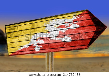 Bhutan Flag wooden sign on beach background - stock photo